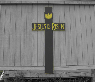 "Wooden cross inscribed, ""Jesus is risen"""